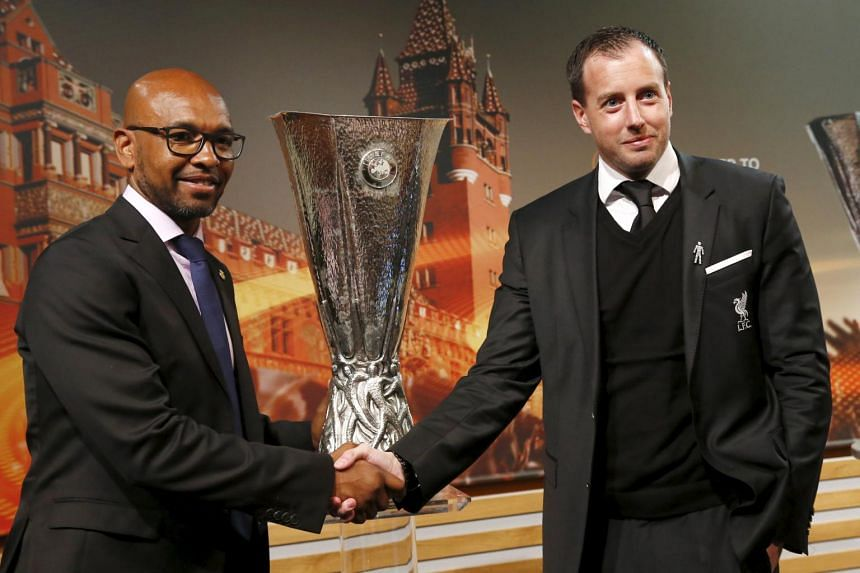 Marcos Senna of Villarreal CF (left) shakes hand with Daniel Stanway, Liverpool FC Club Secretary, after the draw of the UEFA Europa League semi-finals at in Nyon, Switzerland on April 15, 2016.