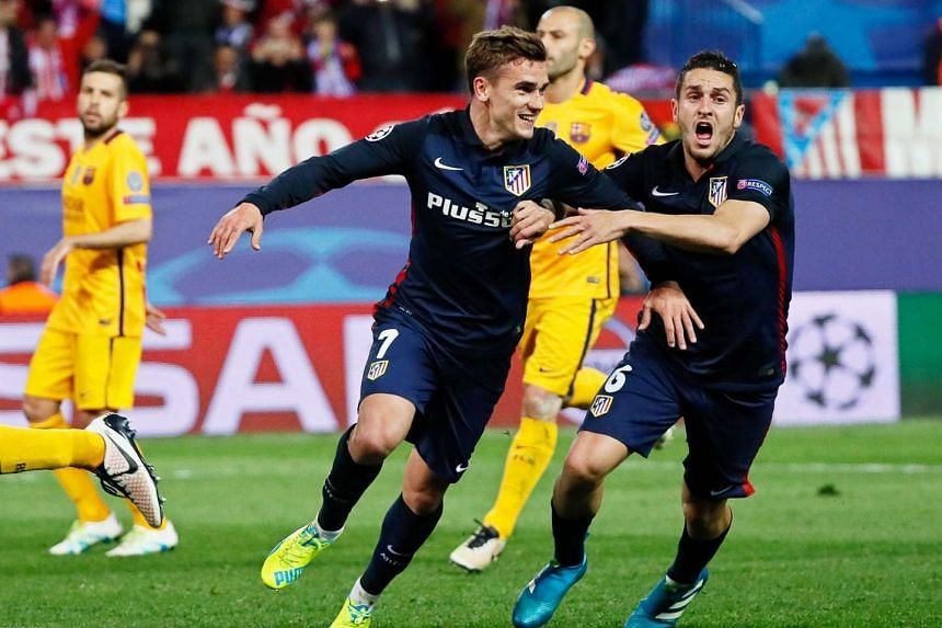 Atletico Madrid's players celebrate after scoring the 2-0 lead from the penalty spot at the Uefa Champions League quarter final, second leg match against FC Barcelona.