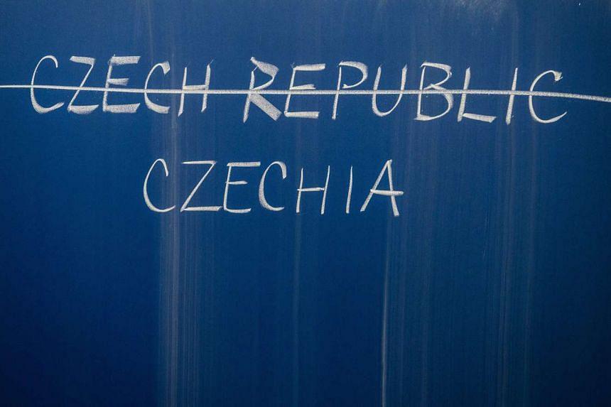 Czechia, the new name for the Czech Republic, is written on a school blackboard in Prague.