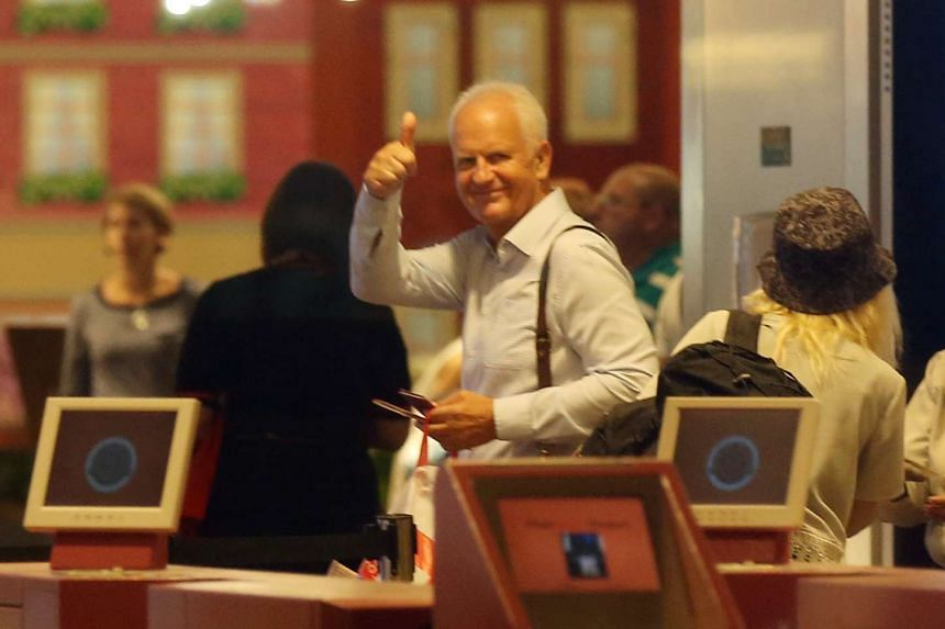 Singapore football coach Bernd Stange gives the thumbs-up to FAS staff at Changi Airport Terminal 1 on April 15, 2016.