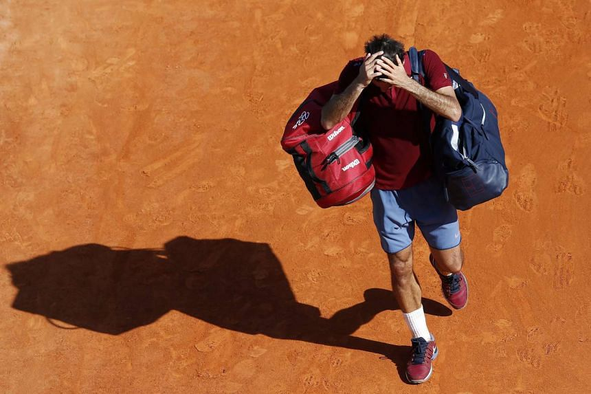 Roger Federer of Switzerland leaves the court after losing against Jo Wilfried Tsonga of France in a quarter final match at the Monte-Carlo Rolex Masters tournament in Roquebrune Cap Martin, France, on April 15, 2016.