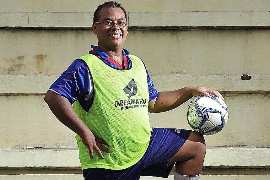 Full-time national serviceman Ismail Abdul Kadir, who experiences uncontrollable trembling in his hands, is excited about training with the national cerebral palsy football team.