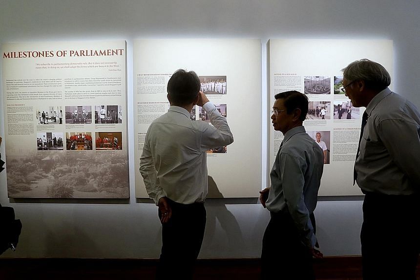 Manpower Minister Lim Swee Say, former DPM Wong Kan Seng and Defence Minister Ng Eng Hen viewing a panel at the launch of The Parliament In Singapore History exhibition at The Arts House on March 23.