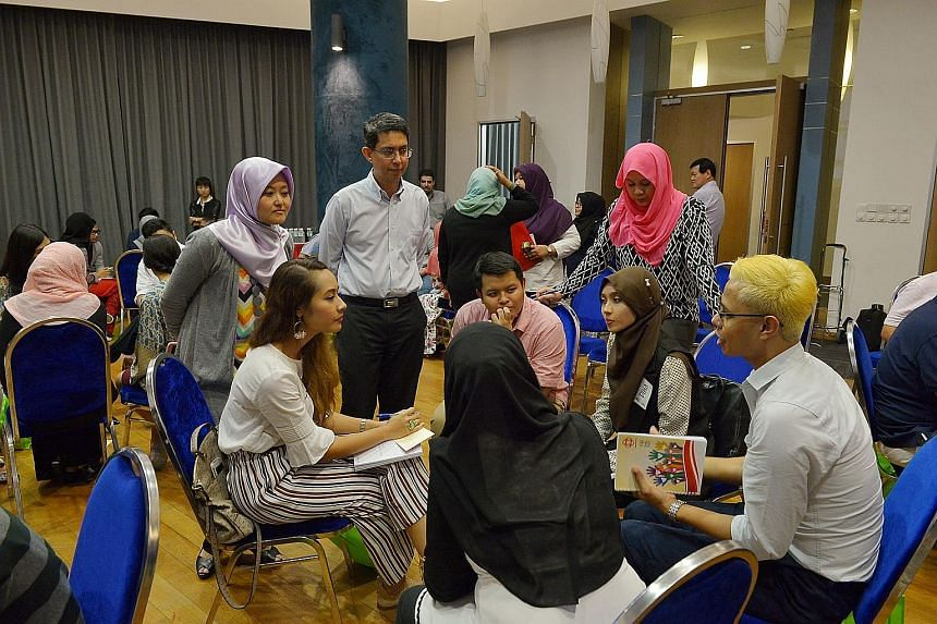 Young people from various Malay-Muslim organisations at a discussion last month about their aspirations for Singapore's future. Listening in were Associate Professor Faishal Ibrahim (standing, second from far left), Parliamentary Secretary for Minist