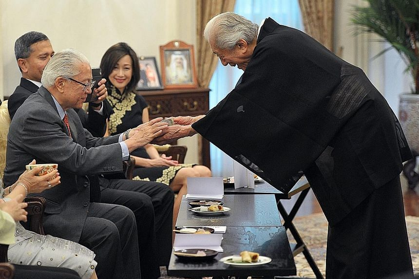 Japanese tea ceremony expert and Unesco goodwill ambassador Sen Genshitsu conducting a tea ceremony at the Istana yesterday for President Tony Tan Keng Yam and Foreign Minister Vivian Balakrishnan. Dr Sen, 93, Urasenke Grand Master XV, is the former