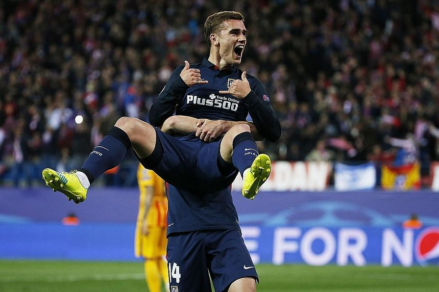 Atletico Madrid's two-goal hero Antoine Griezmann celebrating after scoring his first goal against Barcelona in their Champions League quarter-final, second-leg clash at the Vicente Calderon. Atletico won 2-0 and progressed 3-2 on aggregate.