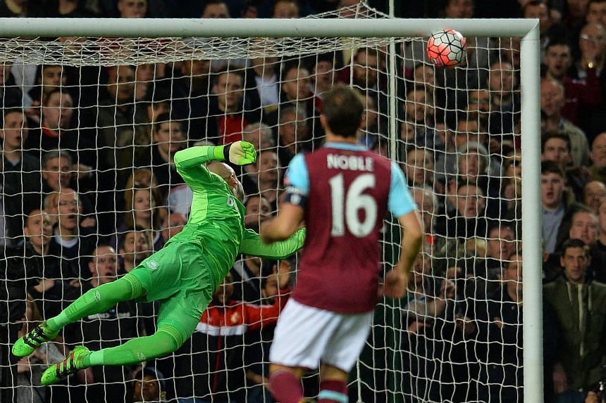 Manchester United's Marcus Rashford (above) scores past West Ham United's goalkeeper Darren Randolph during their FA cup quarter-final replay. The match ended 2-1 in favour of the Red Devils.