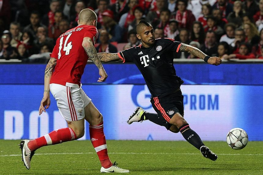 Benfica's Victor Nilsson-Lindelof (left) is powerless to prevent Bayern Munich's Arturo Vidal from equalising during their Champions League quarter-final second-leg 2-2 draw on Wednesday.