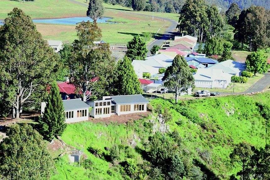 A small, picturesque Australian village has been listed for sale, attracting interest from China and Singapore, with its new buyer set to own dozens of homes, a lake full of fish and 35 highland cattle. Property agent John Blacklow told The Straits T