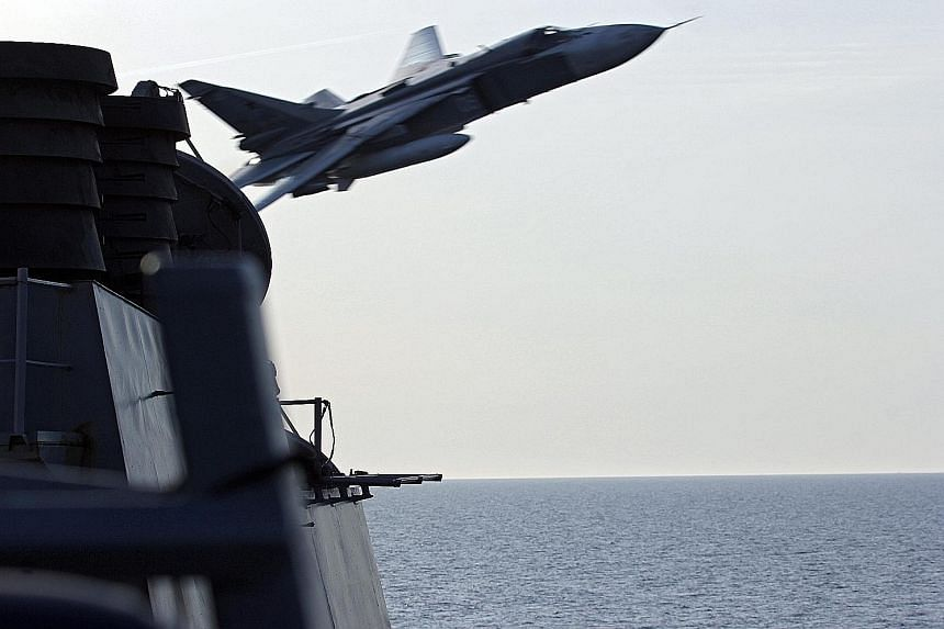 "A US Navy photo shows a Russian Sukhoi Su-24 jet making a very low-altitude pass by USS Donald Cook in the Baltic Sea on Tuesday. It flew within 9m of the ship in a ""simulated attack profile"", the US military's European Command said. Russian military"