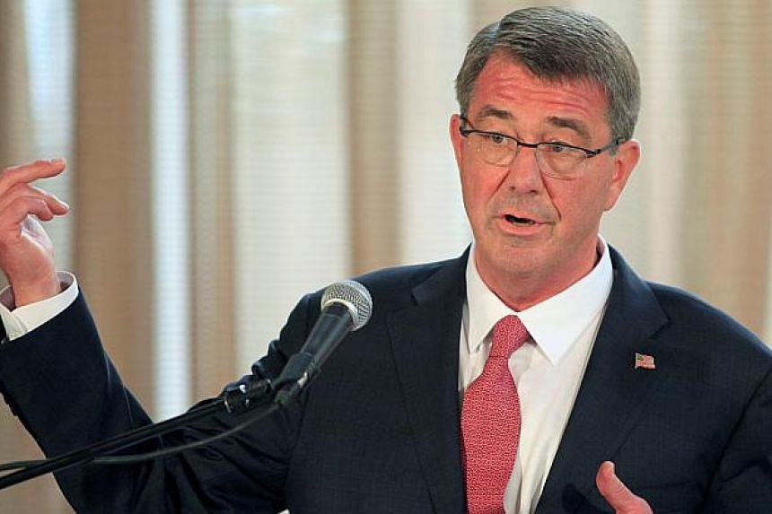 Visiting US Defence Secretary Ash Carter gesturing during a joint press conference with his Filipino counterpart Voltaire Gazmin (not pictured) at the presidential palace in Manila, on April 14, 2016.