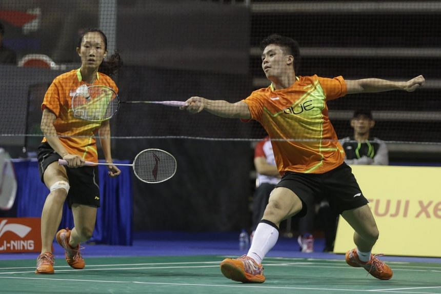 Singapore's Terry Hee (right) and Tan Wei Han in action at the OUE Singapore Open, on April 14, 2016.