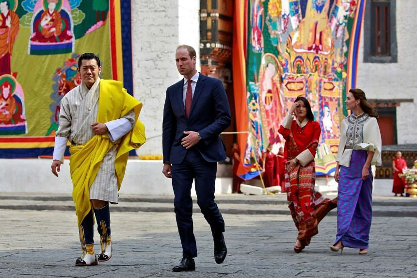 Britain's Prince William and his wife Catherine are shown around the Tashichho Dzong temple by King Jigme Khesar Namgyel Wangchuck and his wife Jetsun Pema, on April 14, 2016.