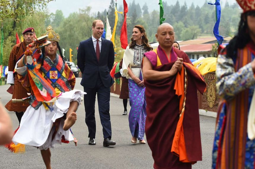 Britain's Duke and Duchess of Cambridge follow a ceremonial procession after arriving at the tshichodzong to meet the King and Queen of Bhutan in Thimphu, on April 14, 2016.