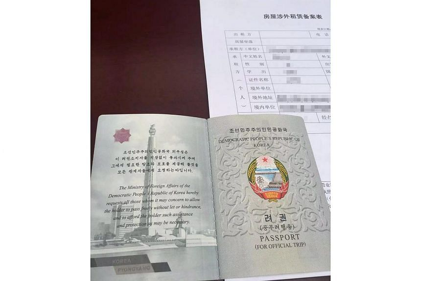 A passport and Chinese documents held by one of the 13 North Korean restaurant workers stationed in China who defected to South Korea.