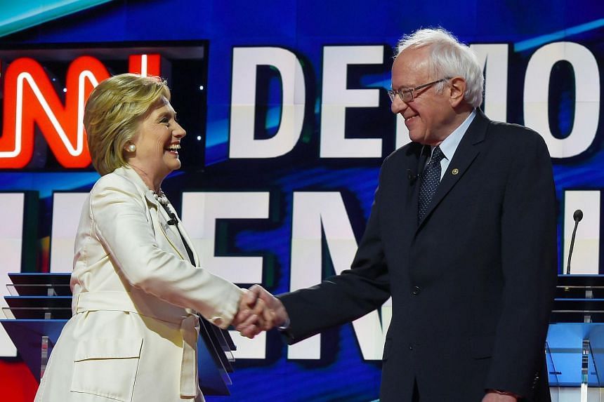 US Democratic presidential candidates Hillary Clinton (left) and Bernie Sanders shake hands before the CNN Democratic Presidential Debate, on April 14, 2016.