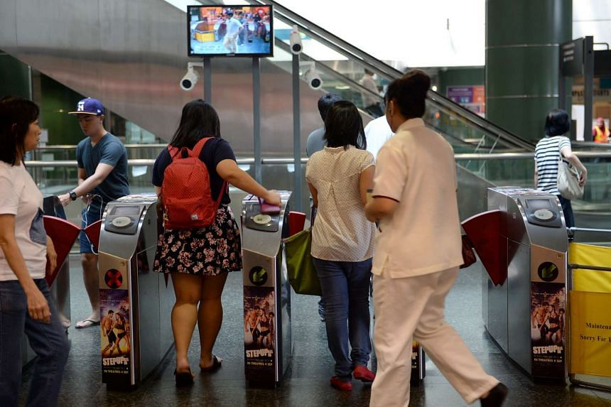 Commuters crossing the gantries at Seng Kang MRT station.