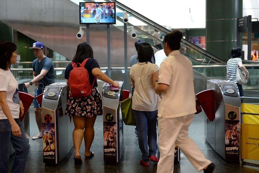 Commuters crossing the gantries at Seng Kang MRT station.