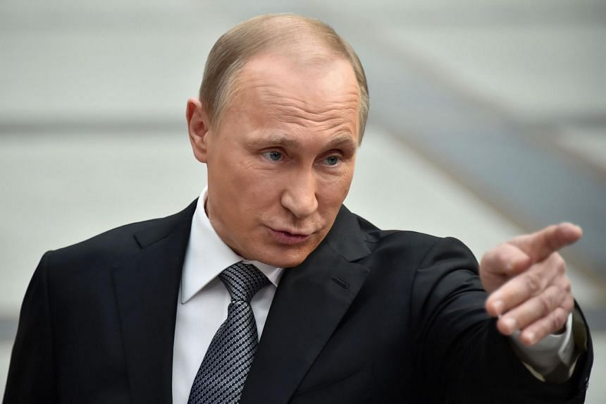 Russian President Vladimir Putin gesturing while speaking with the media after his annual televised call-in show in central Moscow on April 14, 2016.