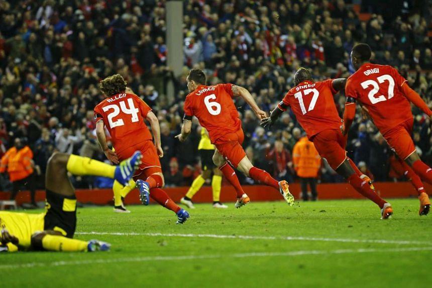 Liverpool's Dejan Lovren celebrates scoring their fourth goal with teammates.