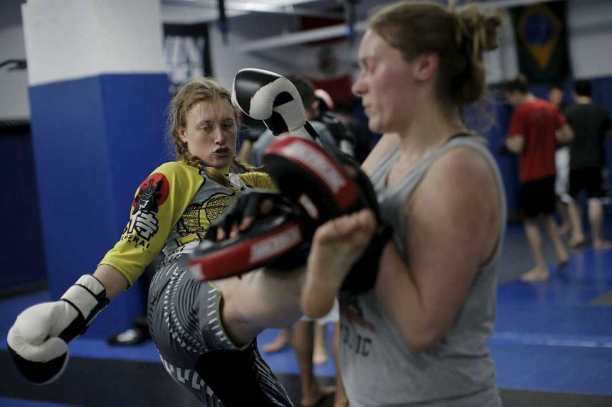 Sam Erenberger (left) trains with a partner at a mixed martial arts gym in midtown Manhattan in New York.