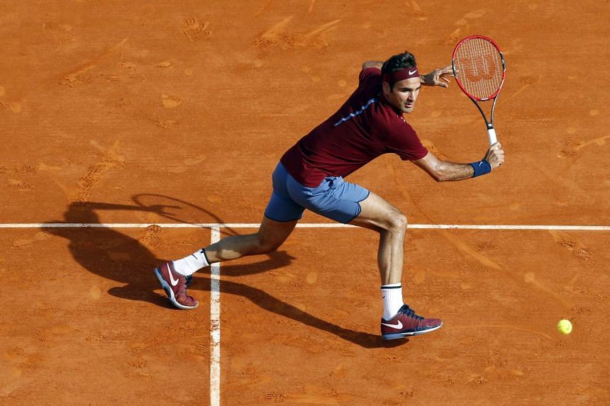 Switzerland's Roger Federer returns a backhand to Spain's Roberto Bautista Agut during their match at the Monte-Carlo ATP on Thursday.
