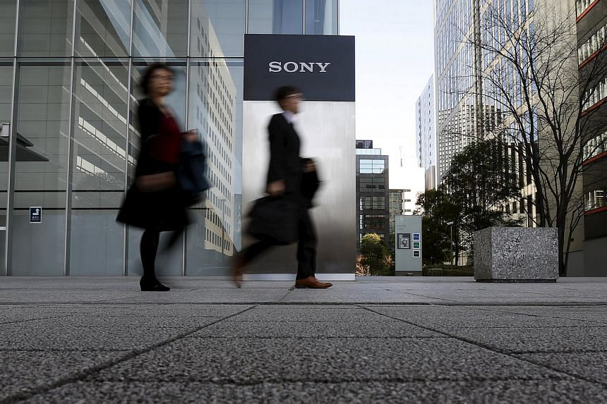 People walk out from Sony Corp's headquarters in Tokyo, Japan, on Jan 27, 2016.