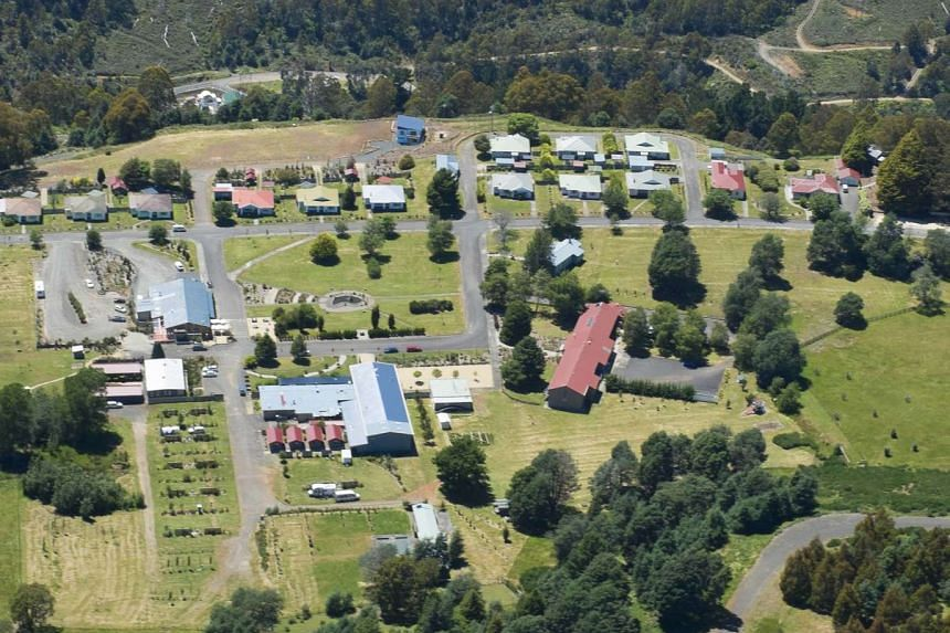 An aerial view of Tarraleah village in Tasmania, Australia. The 145.5ha village is less than one-third the size of Sentosa island. The new owner of the property is set to own dozens of homes, a lake full of trout and salmon and 35 highland cattle.