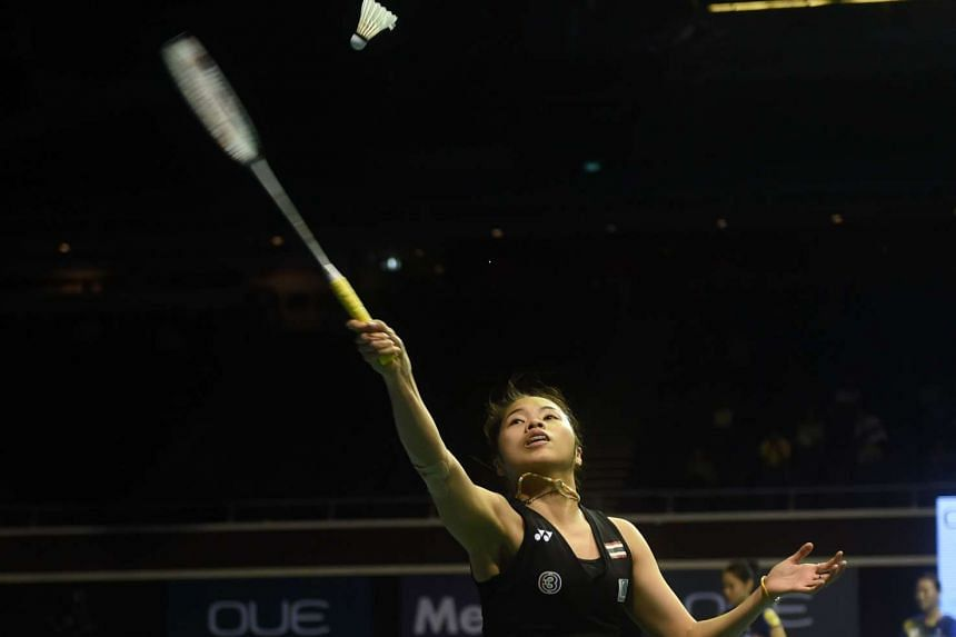 Thailand's Ratchanok Intanon returns a shot against Japan's Akane Yamaguchi at the women's singles semi-final badminton match at the Singapore Open on April 16, 2016.