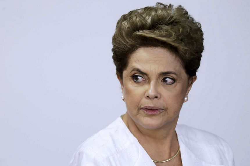 Brazil's President Dilma Rousseff looks on during a signing of federal land transfer agreement in Brasilia, Brazil on April 15, 2016.