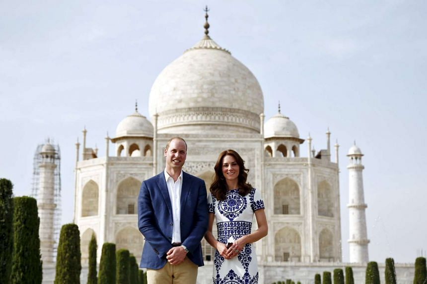 Prince William and his wife Catherine, the Duchess of Cambridge, pose in front of the Taj Mahal on April 16, 2016.