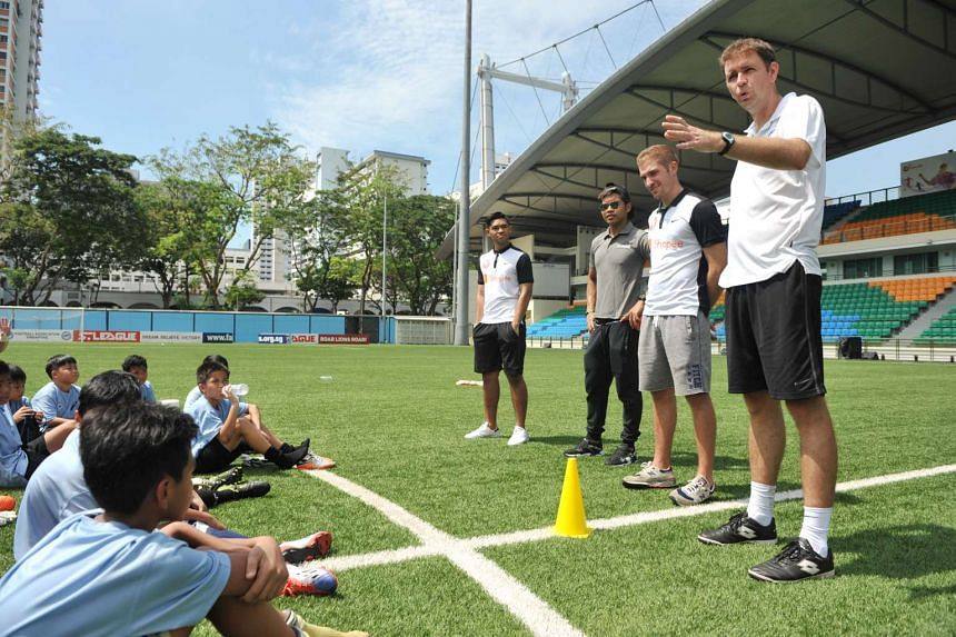 FAS goalkeeper coach Frederic de Boever (far right) debriefs the young custodians at the end of a GAS training session at the Jalan Besar Stadium.