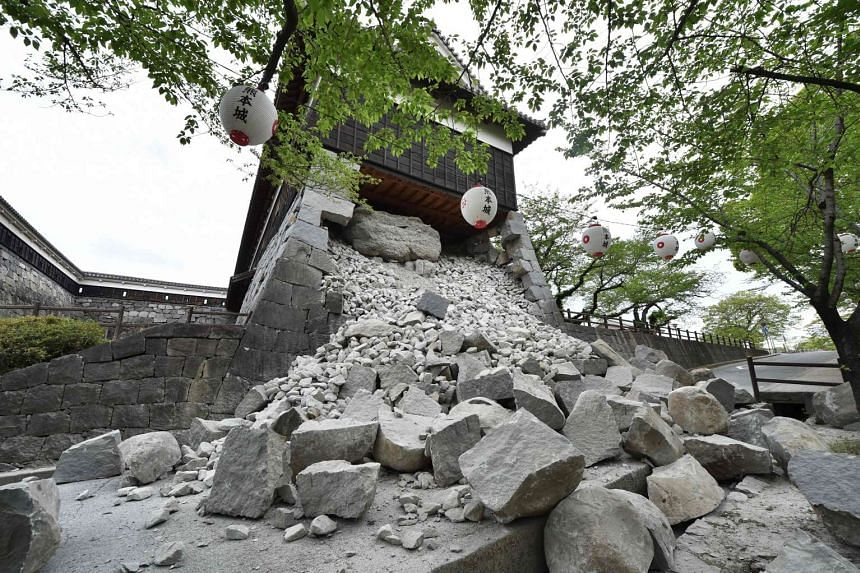 A collapsed stone wall of the Kumamoto Castle after an earthquake struck Kumamoto on April 16, 2016.