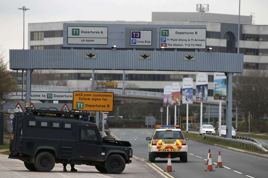 An armed police vehicle at Manchester Airport in Britain on March 22, 2016.