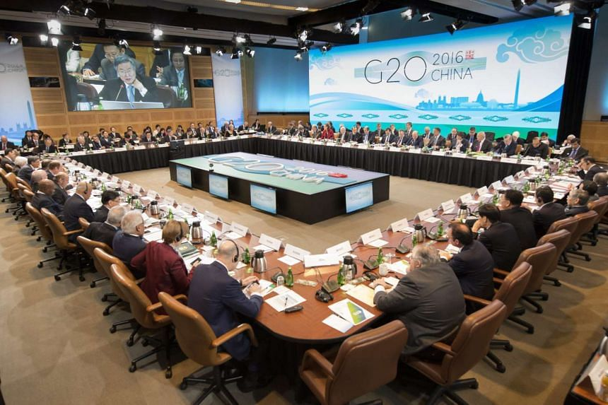 A handout image released by the International Monetary Fund (IMF) on April 15, 2016 shows members attending a G20 meeting in Washington, DC, USA.