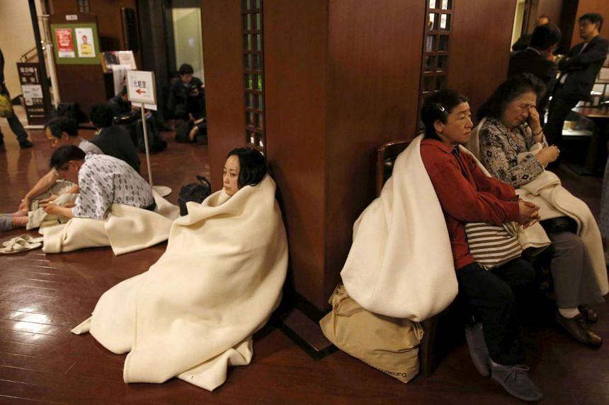 Hotel guests gather at the lobby after another earthquake hit the area in Kumamoto, southern Japan, in this photo taken by Kyodo on April 16, 2016.