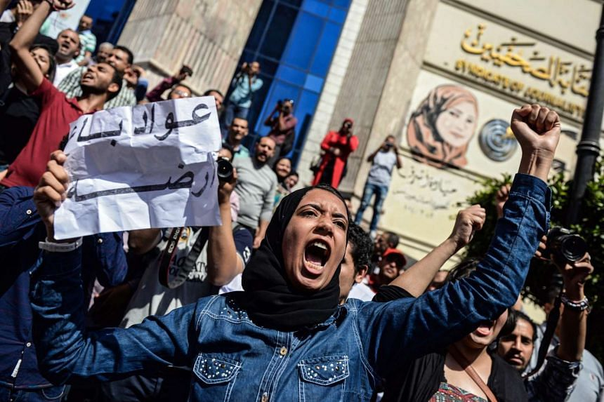 A protester shout slogans in front of the Egyptian Journalists Syndicate, in Cairo, Egypt, on April 15, 2016.