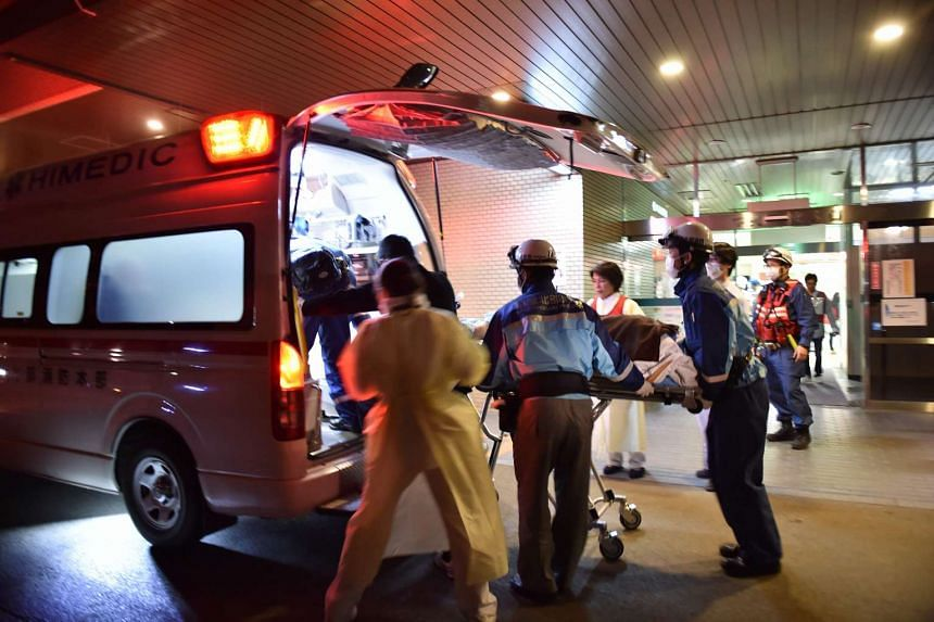 A patient is evacuated by emergency staff to an hospital in Kumamoto City on April 16, 2016.