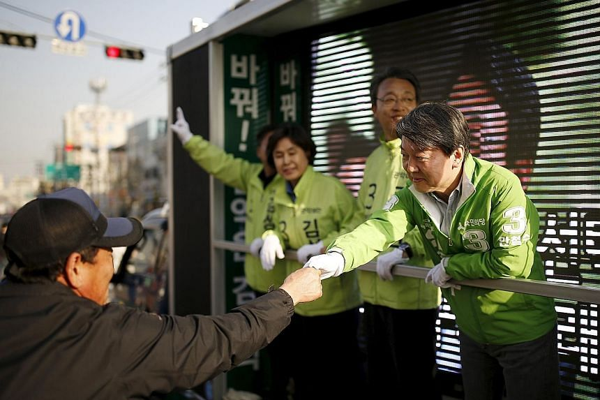 Mr Ahn greeting a supporter during hustings for Wednesday's elections, in which his People's Party won 38 seats. With the two main parties not holding a majority - Saenuri with 122 seats and Minjoo with 123 - Mr Ahn could hold the deciding vote on le