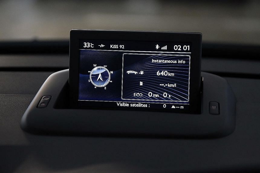 The new Peugeot 3008 (left) is decently equipped with goodies including a pop-up infotainment display (above).