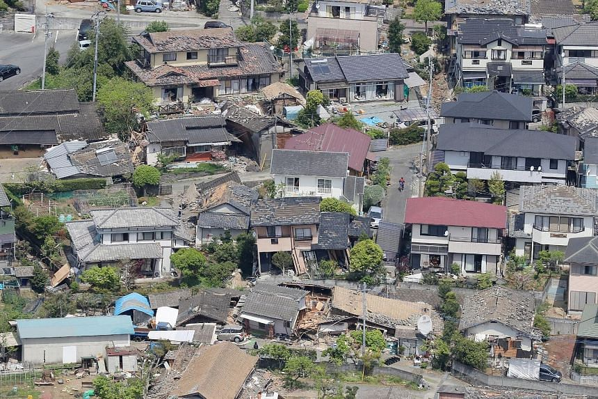 An aerial view of damaged houses in the town of Mashiki in Kumamoto prefecture yesterday, after a 6.5-magnitude earthquake hit Japan's south-western island of Kyushu the night before. Mashiki, a town of around 34,000 people near the epicentre of the