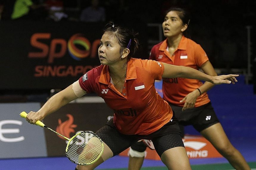Indonesia's Greysia Polii (left) and Nitya Krishinda Maheswari in action against China's Chen Qingchen and Jia Yifan yesterday.