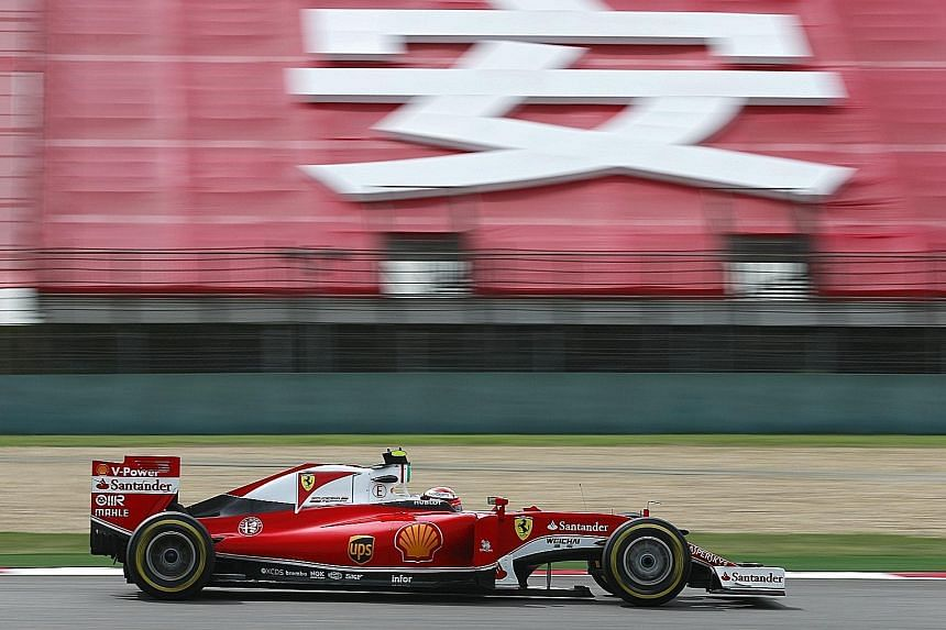 Ferrari's Kimi Raikkonen in action during the second practice session at the Shanghai International Circuit. He clocked the fastest lap of 1min 36.896sec.