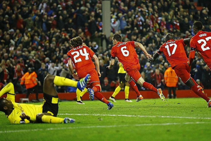 Dejan Lovren (No. 6) could be the leader of a four-man dance troupe as team-mates Joe Allen, Mamadou Sakho and Divock Origi celebrate his goal in added time to seal an amazing 4-3 Europa League victory over Borussia Dortmund on Thursday.