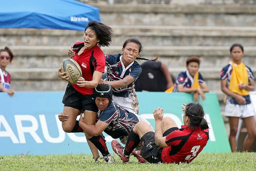 Singapore's Lai Pui San in action during the 28-7 victory against Laos during the SEA 7s group matches at Yio Chu Kang Stadium yesterday. The home side will take on Thailand in today's final.