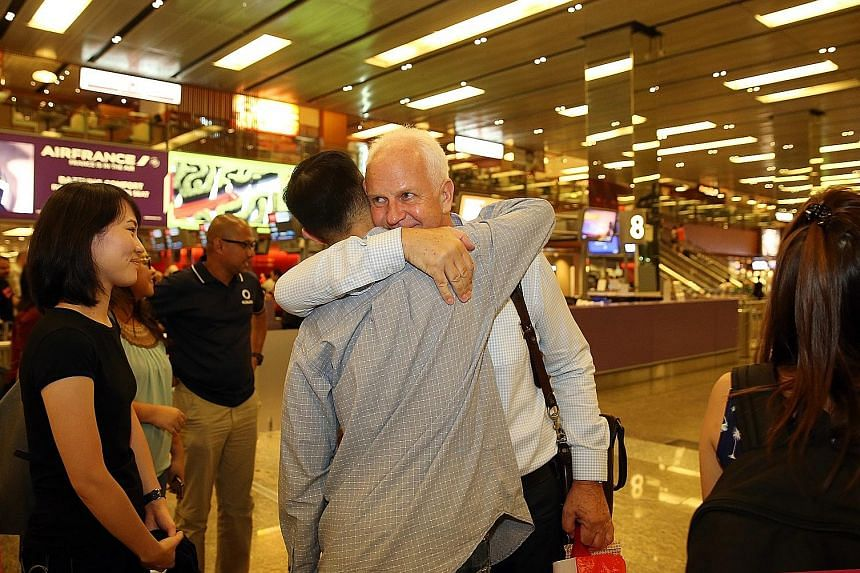 Bernd Stange hugging former and current FAS staff at Changi Airport. He stepped down after three years at the helm of the Lions.
