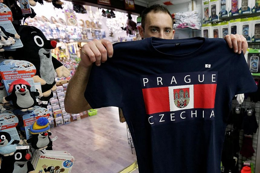 A vendor in the Czech capital Prague with a T-shirt bearing the country's new informal name Czechia.