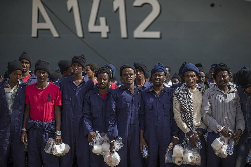 Migrants from Africa at the port of Augusta, Italy, after they were rescued at sea on Tuesday. Austria's leaders fear that as many as 300,000 migrants could arrive in Italy this year and attempt to move north.