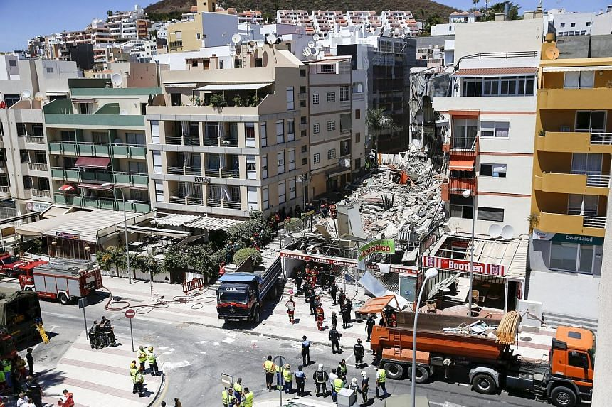 Rescue workers searching for survivors on Thursday after a building collapsed in the beach area of Los Cristianos on Tenerife. It is unclear what caused the collapse.
