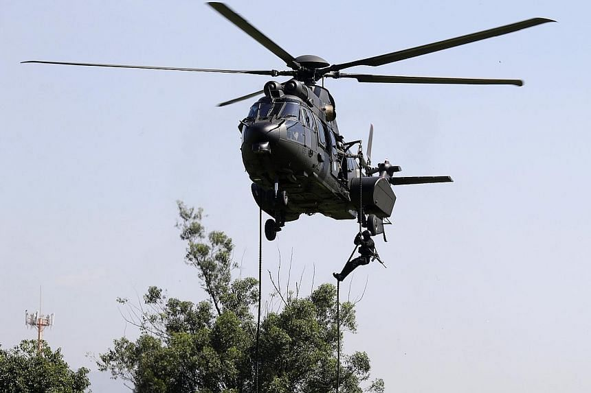 A Brazilian soldier rappelling from a helicopter as part of an exercise on April 6, in the run-up to the Olympics in August.